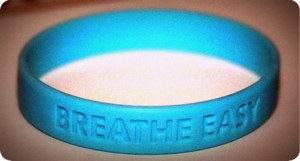 "Purchase ""Breathe Easy"" bracelets by calling the New Jersey State Organization of Cystic Fibrosis (973) 595-1212"